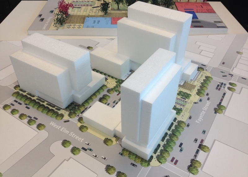 A view of the corner of West Elm and Fayette. The hotel is on the corner. You can see Washies just to the left of it. The other two structures are office buildings. St. Mary's is not included as part of the model, but would be left of the building shown on the far left.